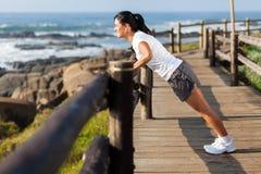 Woman exercising beach Stock Photography