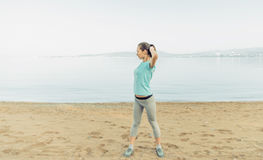 Woman exercising on beach Royalty Free Stock Image