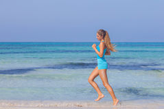 Woman exercising on beach seashore stock images