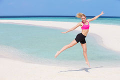 Woman Exercising On Beautiful Beach Royalty Free Stock Image