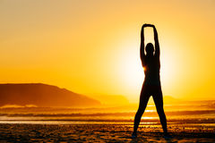 Woman exercising on beautiful sunset Stock Photo