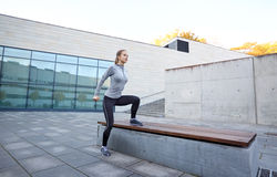 Woman exercising on bench outdoors Royalty Free Stock Image