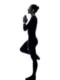 Woman exercising bhujangasana cobra pose yoga silhouette. Shadow white background royalty free stock images