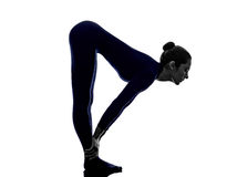 Woman exercising bhujangasana cobra pose yoga silhouette Stock Image