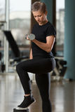 Woman Exercising Biceps With Dumbbells Royalty Free Stock Photos