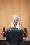Woman exercising on bicycle Stock Images