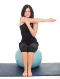 Woman exercising with big blue ball Royalty Free Stock Photos
