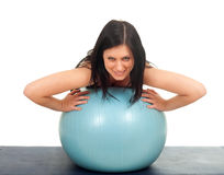 Woman exercising with big blue ball Stock Photography