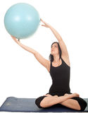 Woman exercising with big blue ball Royalty Free Stock Images