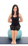 Woman exercising with big blue ball Stock Photo