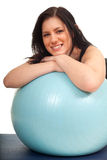 Woman exercising with big blue ball Stock Image
