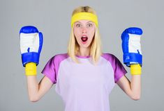 Woman exercising with boxing gloves. Boxing sport concept. Cardio boxing exercises to lose weight. Femininity and. Strength balance. Woman boxing gloves enjoy royalty free stock photo