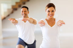 Woman exercising with boyfriend Stock Images
