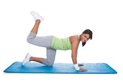 Woman exercising buttocks Stock Image