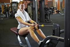 Woman exercising on cable machine Stock Photo