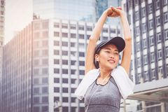 Woman is exercising in the city.  Stock Images
