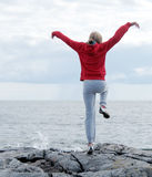 Woman exercising on cliff royalty free stock photos