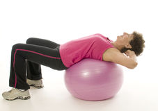 Woman exercising core training fitness ball Stock Images