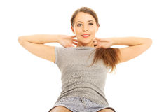 Woman exercising crunches Stock Images