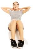 Woman exercising crunches Stock Photos