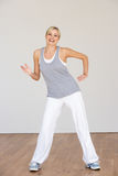 Woman Exercising In Dance Studio Royalty Free Stock Photo