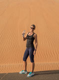 Woman exercising in the desert. Stock Photo