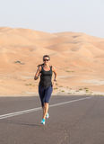 Woman exercising in the desert. Royalty Free Stock Image
