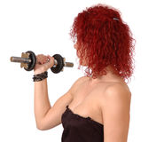 Woman exercising with dumbbell royalty free stock photos