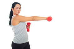 Woman exercising with dumbbell Stock Photography