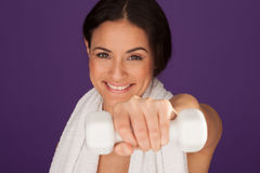 Woman exercising with a dumbbell Stock Images