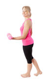 Woman exercising with dumbbell stock photos