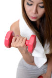 Woman is exercising with dumbbell. Royalty Free Stock Photos