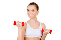 Woman exercising with dumbbells. Stock Photo