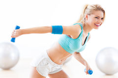 Woman exercising with dumbbells Stock Photo