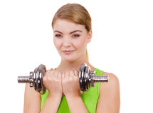 Woman exercising with dumbbells lifting weights Stock Photography