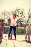 Woman exercising with dumbbells outdoor Stock Photo