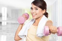 Woman exercising with dumbbells Royalty Free Stock Photos