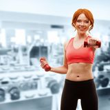 Woman exercising with dumbbells Stock Photography