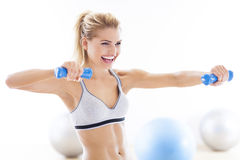 Woman exercising with dumbbells Royalty Free Stock Image