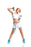 Woman exercising with dumbbells Royalty Free Stock Photo