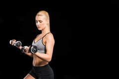 Woman exercising with dumbbells Stock Image
