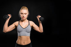 Woman exercising with dumbbells Stock Photos