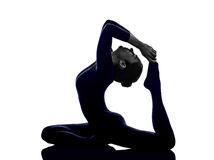 Woman exercising Eka Pada Rajakapotasana One Legged King Pigeon Royalty Free Stock Photography