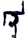 Woman exercising Eka Pada Viparita Dandasana pose yoga silhouett Stock Photos