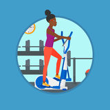 Woman exercising on elliptical trainer. Royalty Free Stock Images