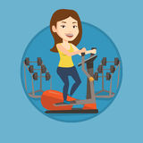 Woman exercising on elliptical trainer. Royalty Free Stock Photography