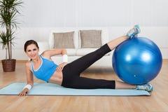 Woman Exercising With Exercise Ball stock photos