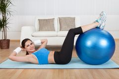 Woman Exercising With Exercise Ball royalty free stock photography