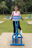 Woman exercising with exercise equipment in the park Royalty Free Stock Photo