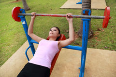 Woman exercising with exercise equipment in the park Stock Photo